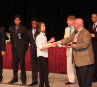 Angela accepts award