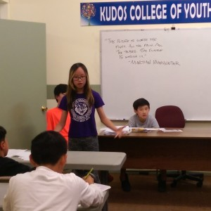 Sharon Liu, Level II student giving an Impromptu speech to Elementary studnets