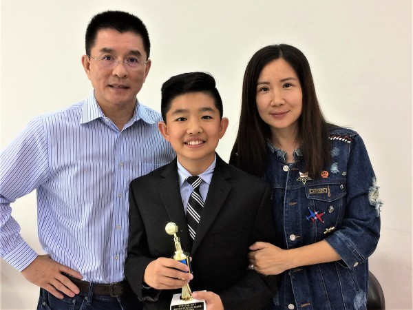 Aaron Zhang with his proud parents, Aaron won Top Speaker award in LD