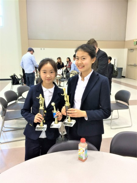 Grace Jin and Abigail Fang took the PF champion trophies home