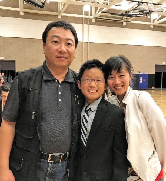 Ryan Sieh with his parents